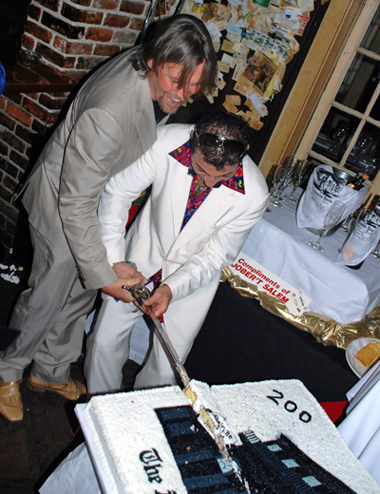 George Rowley with owner of Old Absinthe house NewOrleans cutting Birthday cake