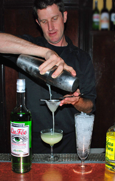 Mixologist making cocktail using La Fée absinthe