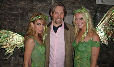 George Rowley with two Lucid fairies at their launch