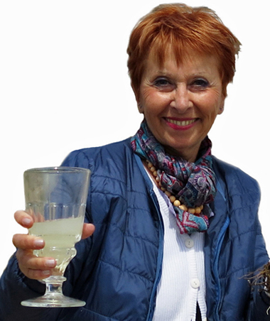 Marie-Claude Delahaye with glass of La Fée Absinthe