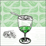 Sugar cube on absinthe spoon on glass of La Fée Absinthe