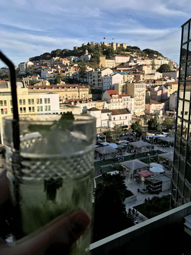 ENVY Mojito with back drop of Lisbon castle